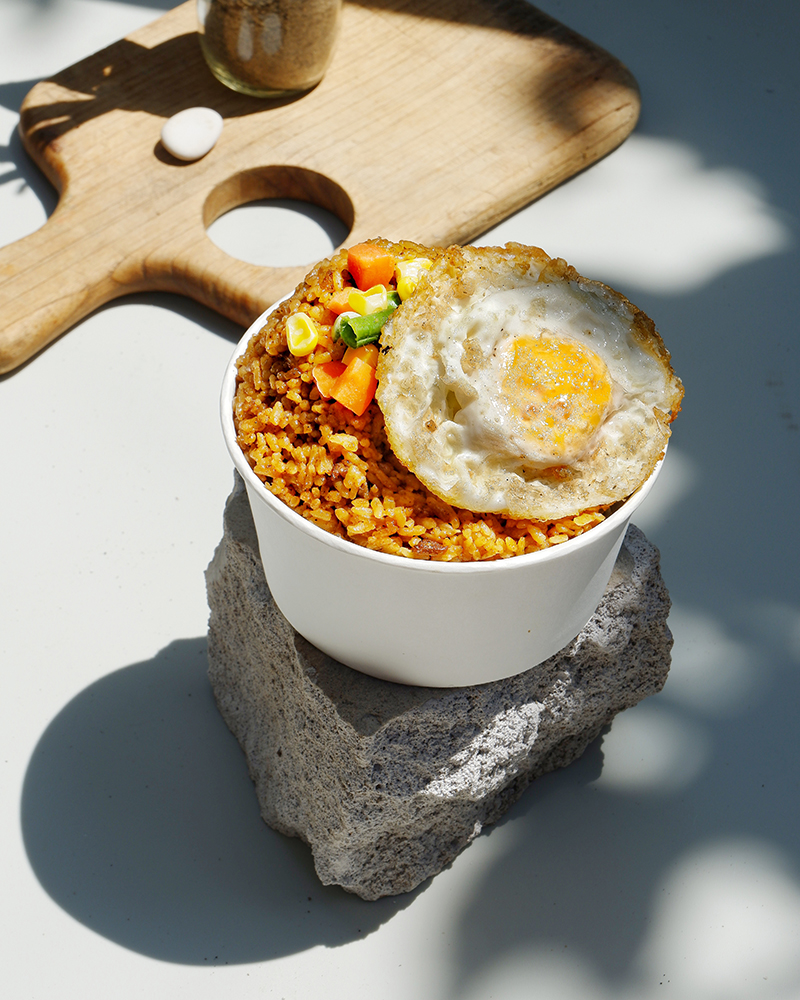 Bowl of fried rice with sunny side up egg, shot for a home business in Indonesia. PIXERF.