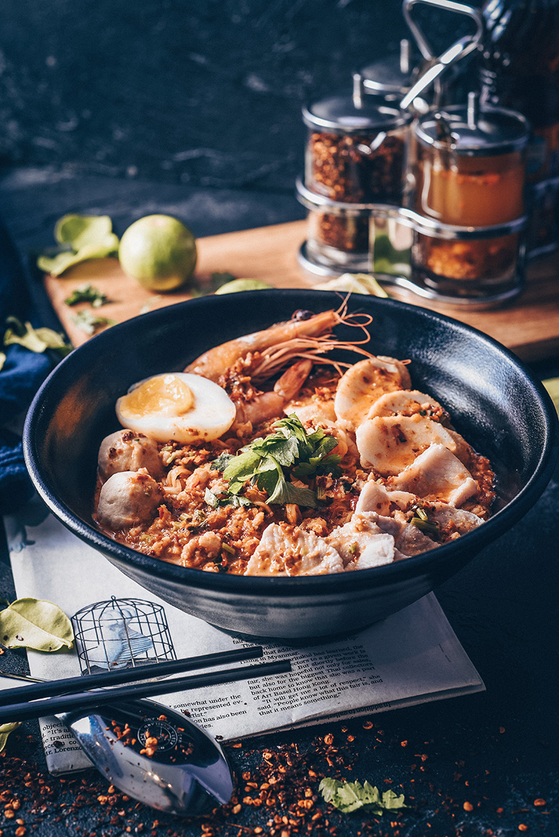 Asian food: Spicy Thai Seafood Noodles with prawns, eggs, and meatballs. Photo by Jun Sin, PIXERF