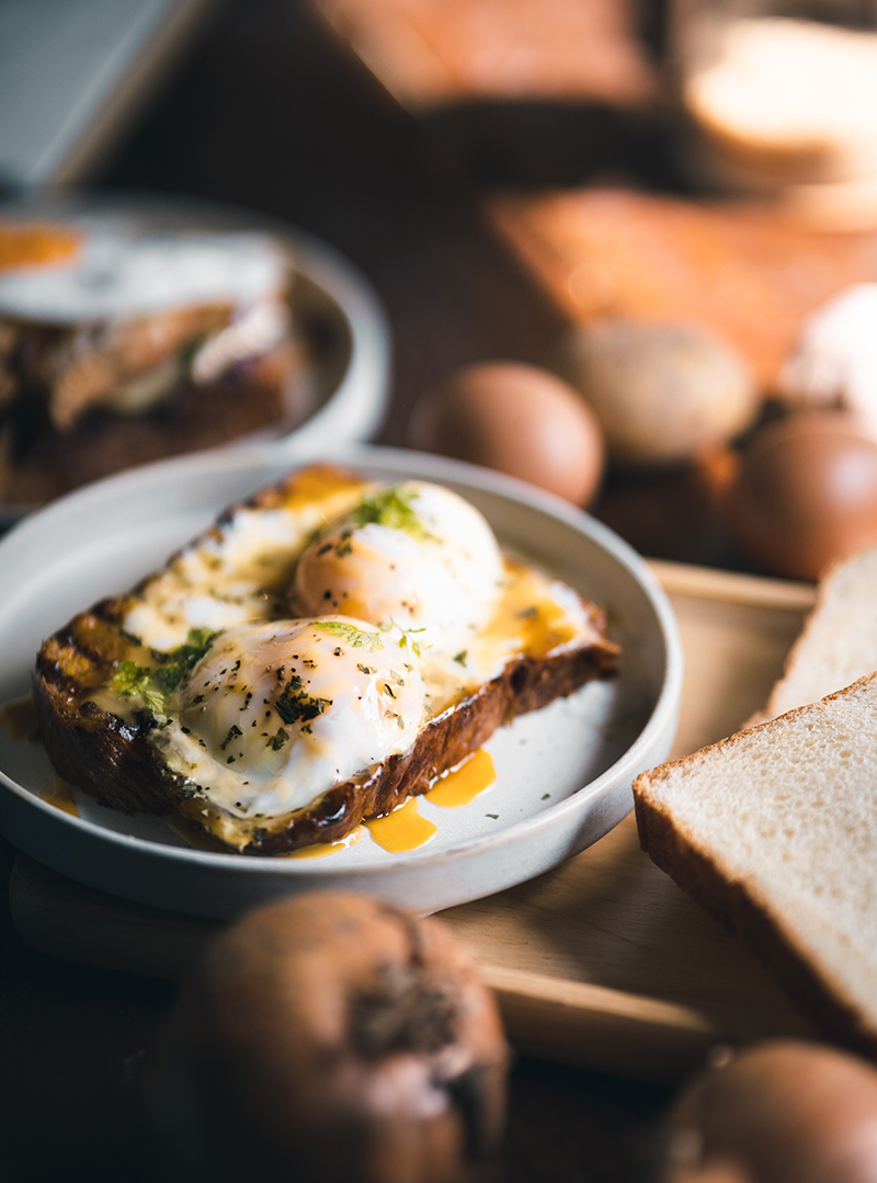 Poached eggs on toast for breakfast. PIXERF.