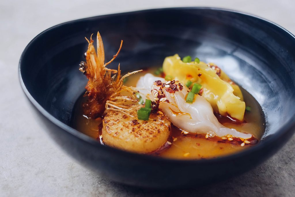 Chinese seafood dumpling soup with scallop and prawns. PIXERF.